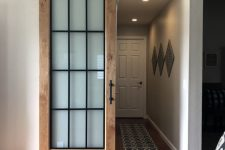 a stylish barn door is a cute rustic touch to any interior