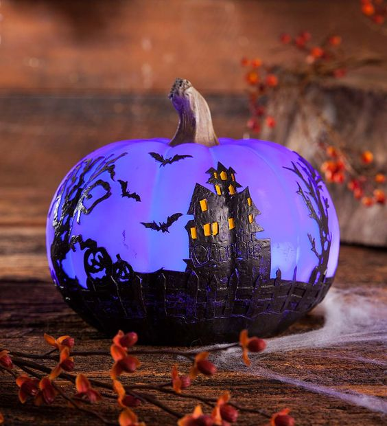 a beautiful painted purple pumpkin with a Halloween scene is a gorgeous decoration for Halloween