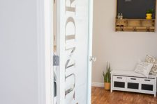 08 a frosted glass laundry door with letters is a cool and fresh idea to try for a modern farmhouse home