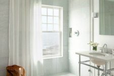 09 a neutral bathroom with a shower space with a window that can be covered with a semi sheer curtain when privacy is needed