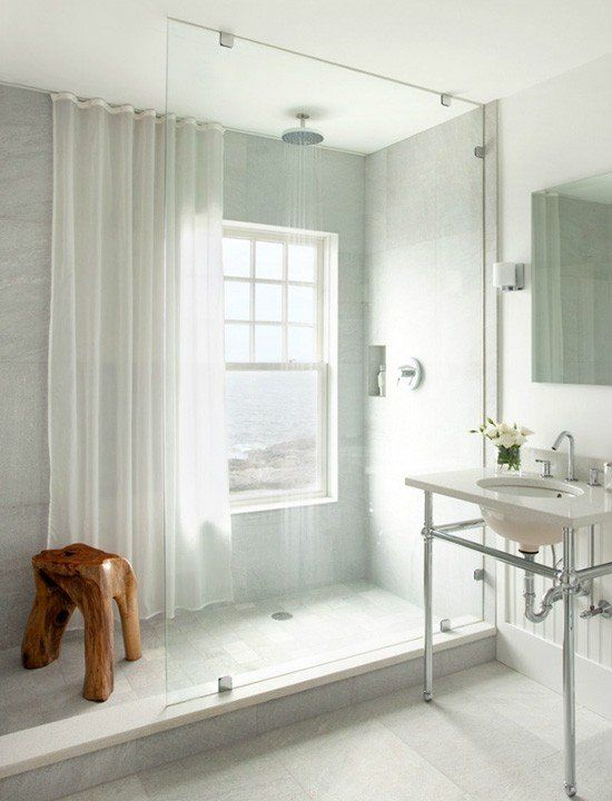 a neutral bathroom with a shower space with a window that can be covered with a semi sheer curtain when privacy is needed