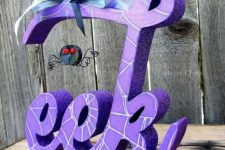 10 a bold purple glitter Halloween decoration with a little fun spider and a blue bow on top is ideal for Halloween