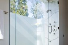 a minimalist neutral bathroom design with frosted glass