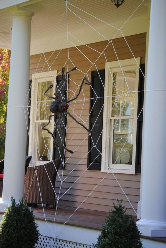 decorate your front porch with a giant spiderweb and a black spider and you will get a Halloween porch at once, without additional decor