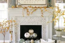 10 modern farmhouse fireplace styling with neutral and pastel pumpkins, potted plants around and some pumpkins on the mantel