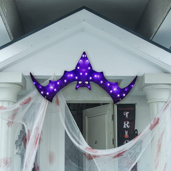 a bold and pretty purple bat marquee light over the entrace instead of a wreath or another Halloween door decoration