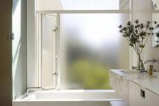 a stylish minimalist bathroom design with frosted glass window