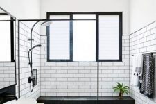 13 a framed window in the shower for enjoying natural light and forsted glass used to keep the privacy on