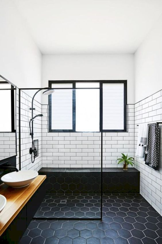 a framed window in the shower for enjoying natural light and forsted glass used to keep the privacy on