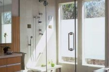 13 a modern bathroom with a shower space enclosed in glass and two windows partly done with frosted glass is a lovely idea