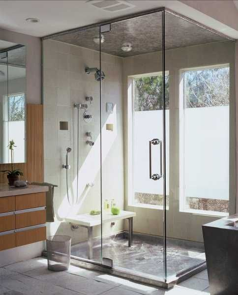 a modern bathroom with a shower space enclosed in glass and two windows partly done with frosted glass is a lovely idea