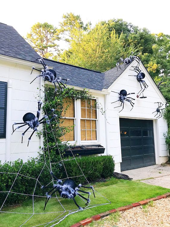 giant black spiders with a touch of fluff and spiderweb are great for styling your home outdoors, attach them to the walls and ground