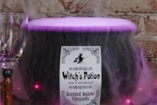 17 a cauldron with purple lights and purple smoke is a cool idea for Halloween decor for a bold touch