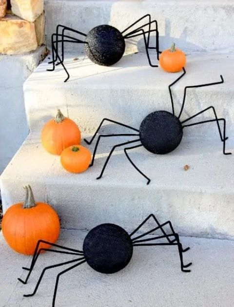 orange pumpkins and black round spiders with legs are fun and playful and are very easy to make yourself