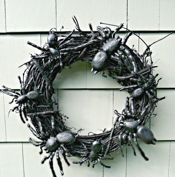 a black Halloween wreath with large black spiders is a lovely idea for decorating your front door and not only - DIY one