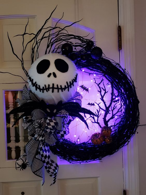 a Jack Skellington vine wreath with bats, a tree and purple lights is a fab idea for Nightmare Before Christmas fans