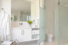20 a blue frosted glass toilet partition for more privacy and even a slightly colored touch to the neutral space