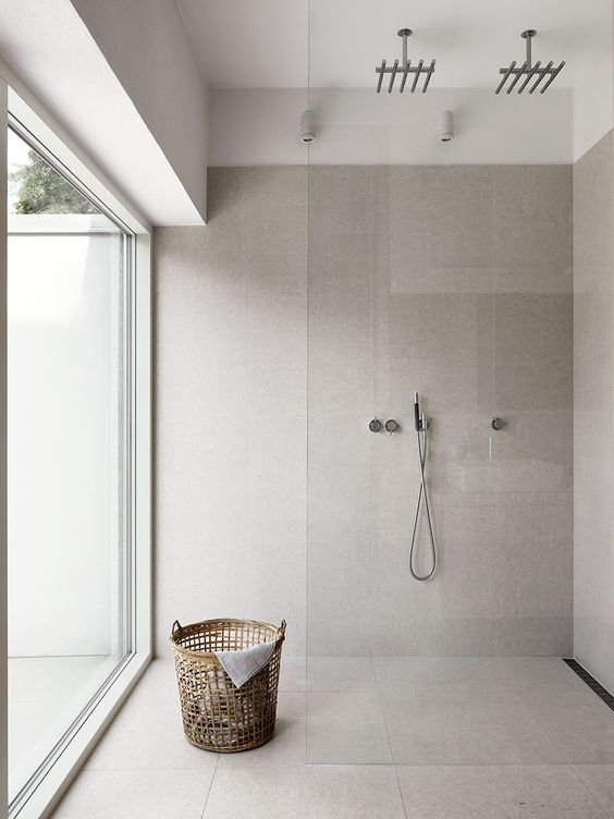a full height window allows amazing views and much natural light making the bathroom modern and peaceful