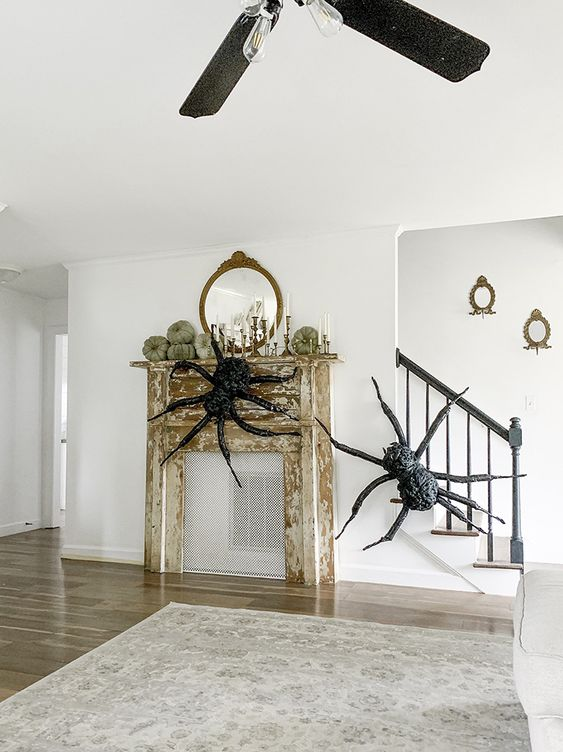 a duo of giant realistic spiders will easily turn your space into a Halloween one and will do that with style