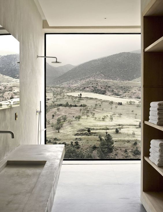 a fully glazed wall in the shower lets enjoy the stunnung views and there no neighbors, so no privacy needed