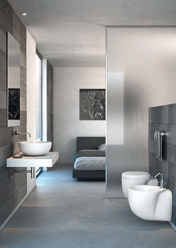 a contemporary bedroom with an en-suite bathroom that is divided from it only with a frosted glass space divider is a gorgeous idea to go for