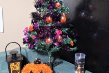 22 a purple and green tabletop Halloween tree with lights and ornaments is a cool decor idea that you can DIY