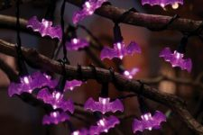 23 branches interwoven with purple bat lights are gorgeous for Halloween decor with a purple touch