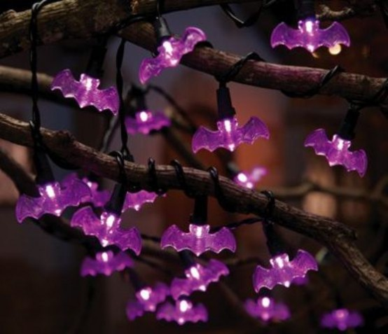 branches interwoven with purple bat lights are gorgeous for Halloween decor with a purple touch