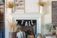 24 fall fireplace styling with a tray with heirloom pumpkins, blooms and wheat in a wooden bucket plus wheat in jugs on the mantel
