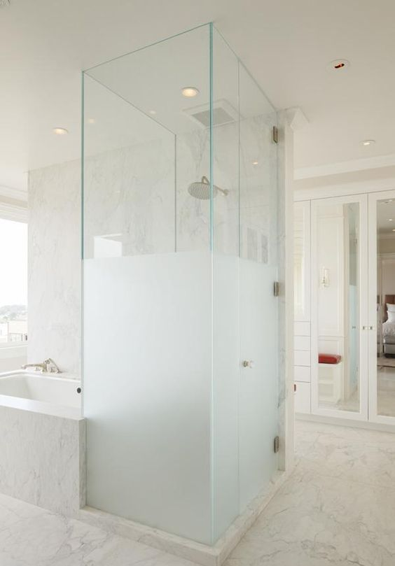 a half frosted glass shower next to the bathtub is a gorgeous contemporary bathroom decor idea with much privacy