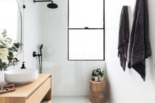 25 a neutral contemporary bathroom with a stained vanity, a clear glass partition and black fixtures plus a window with frosted glass