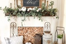 25 farmhouse fireplace styling with wood slices, churns, pumpkins, a tray with prined pillows, greenery and pumpkins on the mantel