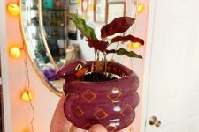 26 a purple snake planter wiht a purple plant is a cool decor idea for Halloween, scary and cute at the same time