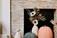 26 lovely fall fireplace styling with colorful pumpkins and a vase with faux blooms is an easy and lovely idea