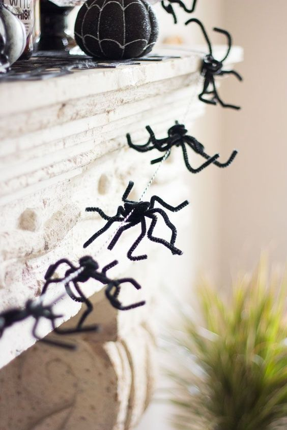a small and cool spider garland is a cool idea for Halloween and it makes any space scarier, such a decoration can be easily made