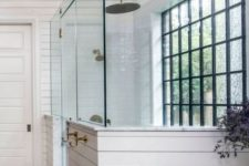 27 a white farmhouse bathroom with a glazed black frame wall, pendant lamps and white marble looks amazing