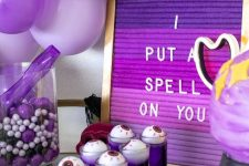 28 a purple Halloween sweets table with purple, black and lilac balloons, an ombre purple sign and various sweets is a cool idea