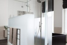 29 a shower space of partly usual and partly frosted glass is ideal to separate it from the rest of the bathroom and make it more private