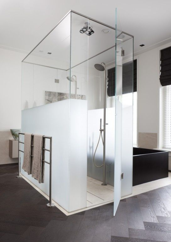 a shower space of partly usual and partly frosted glass is ideal to separate it from the rest of the bathroom and make it more private