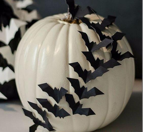 a stylish diy white pumpkin with bats