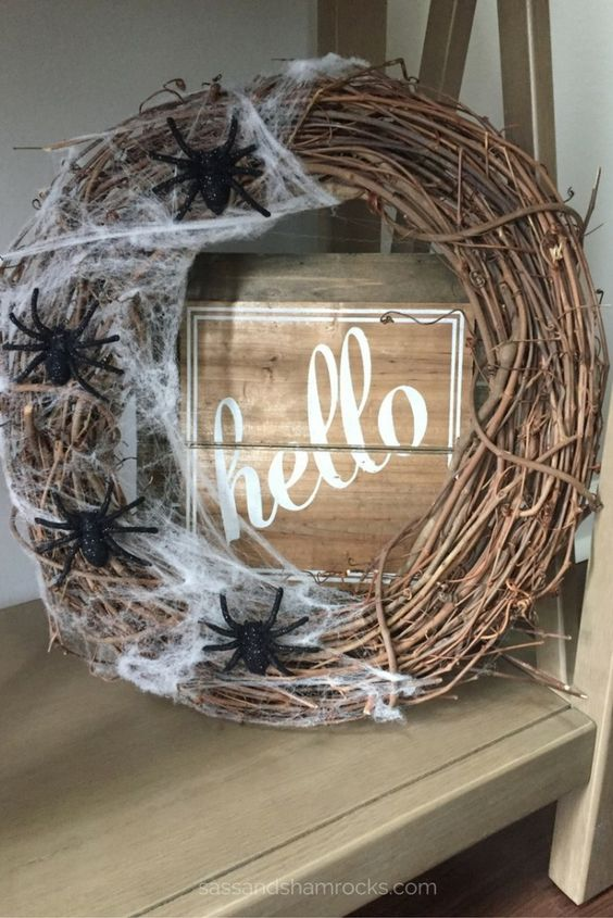 a stylish vine Halloween wreath with realistic spiderweb and black spiders is a cool solution for Halloween and it brings a Halloween feel at once