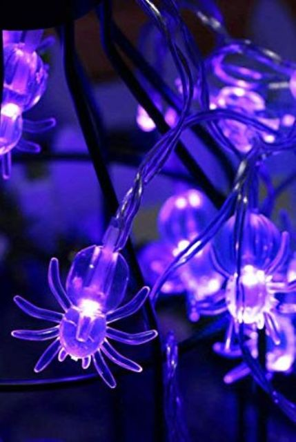 gorgeous sheer purple spider lights will be a cool decoration for Halloween, you can use them absolutely anywhere