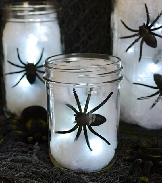 jars with white cotton, black spiders and lights are great as easy DIY Halloween lanterns are great to illuminate your space