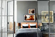 French doors with a modern look in black frames to separate the bedroom from the rest of the apartment in a delicate way