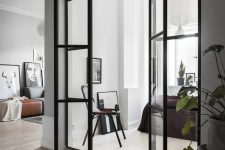 Scandinavian interiors with black framed French doors to fill the spaces with light and connect them with each other