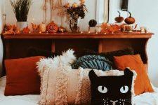a Halloween bedroom decor in cozy fall shades