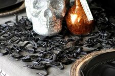 a black rubber snake and insect Halloween placemat is great for styling your table or some other spaces around