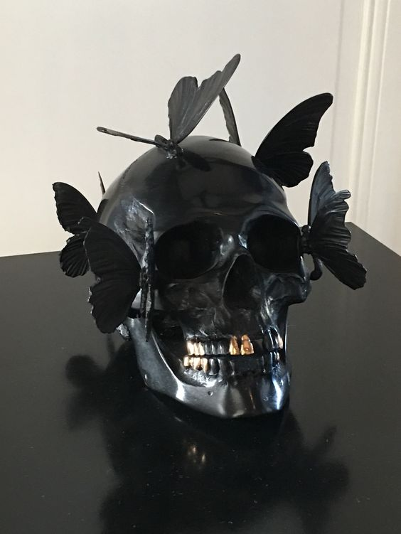 a black skull decorated with butterflies is a gorgeous and very creative Halloween decoration and looks veyr eye-catchy