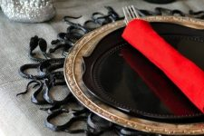 a black snake placemat will make your Halloween tablescape very spooky and special