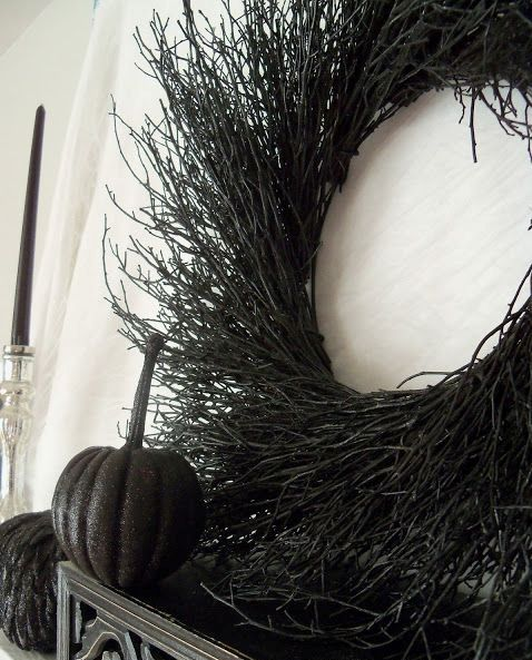 a black twig wreath is a very natural, refined and scary Halloween decor idea that is easy to realize